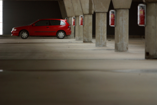 Red car in parking garage